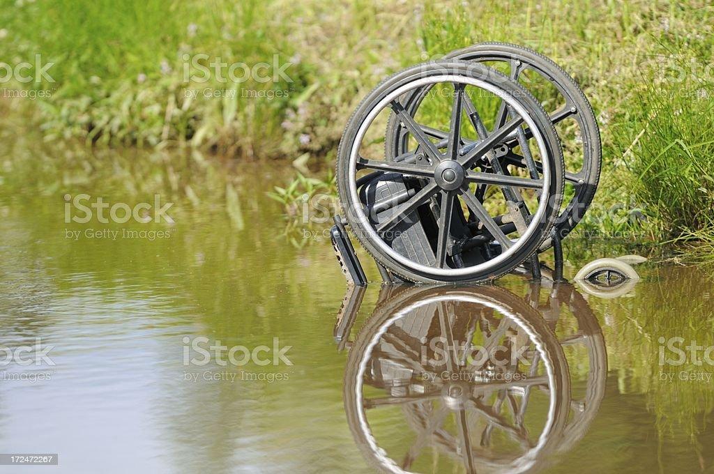Wheelchair in creek royalty-free stock photo