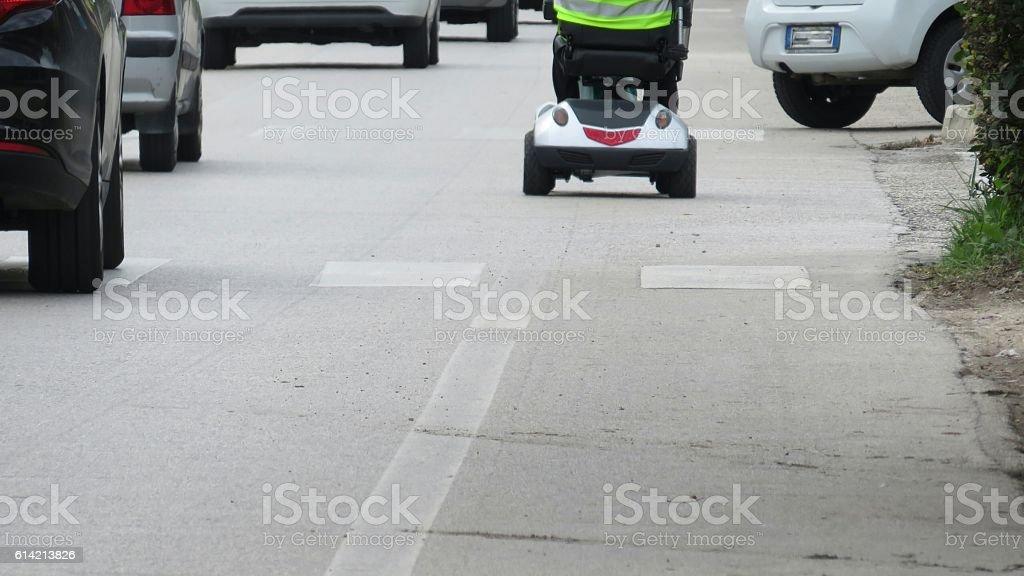 wheelchair into traffic stock photo