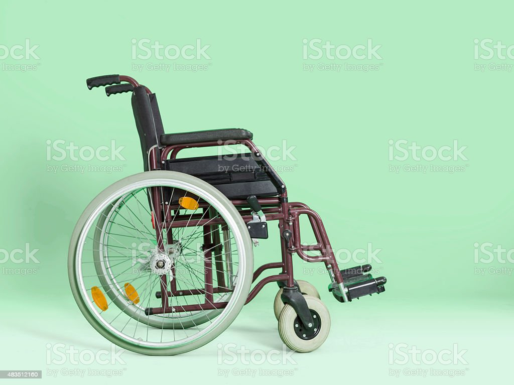 Wheelchair isolated on green background stock photo