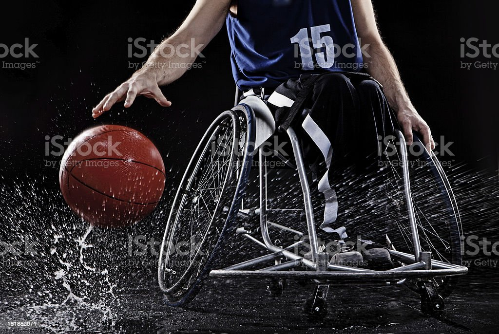 wheelchair man playing basketball stock photo