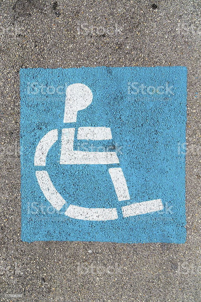 wheelchair sign at the parking lot royalty-free stock photo