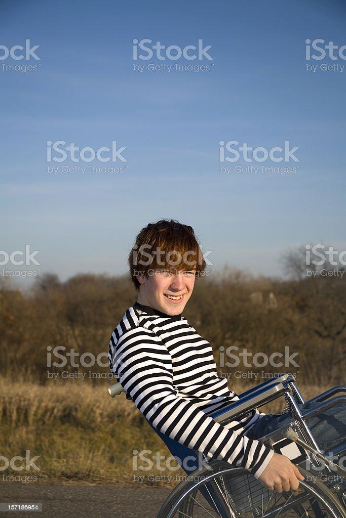wheelchair wheelie stock photo