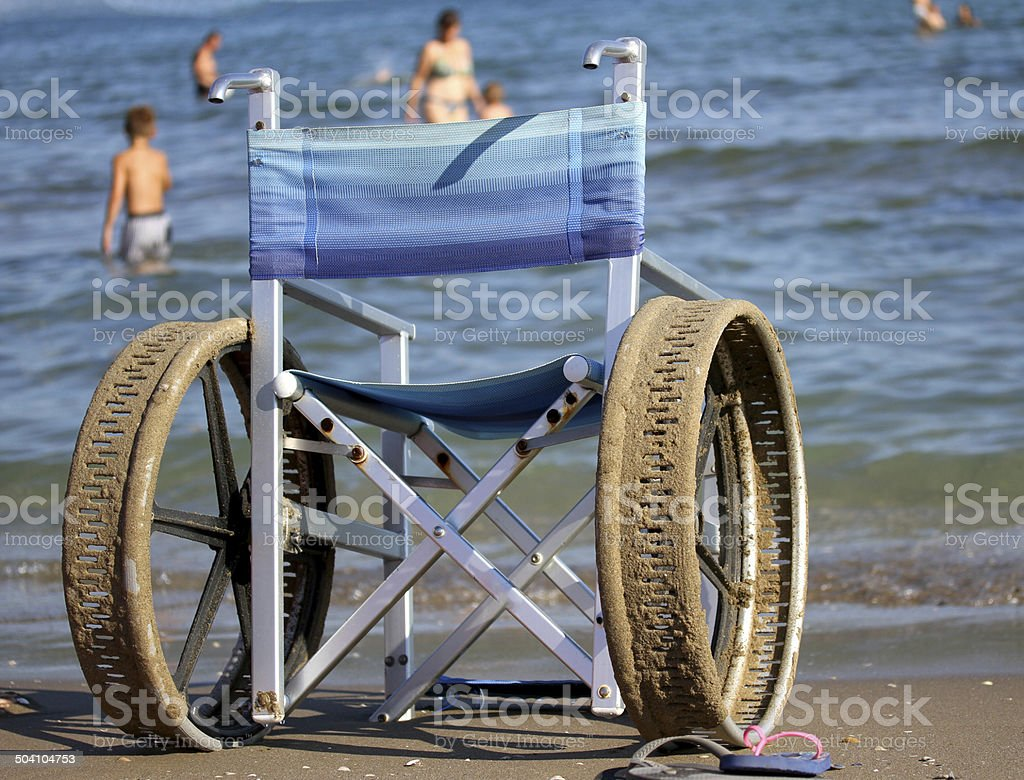 wheelchair with perforated wheels for swimming in the sea royalty-free stock photo