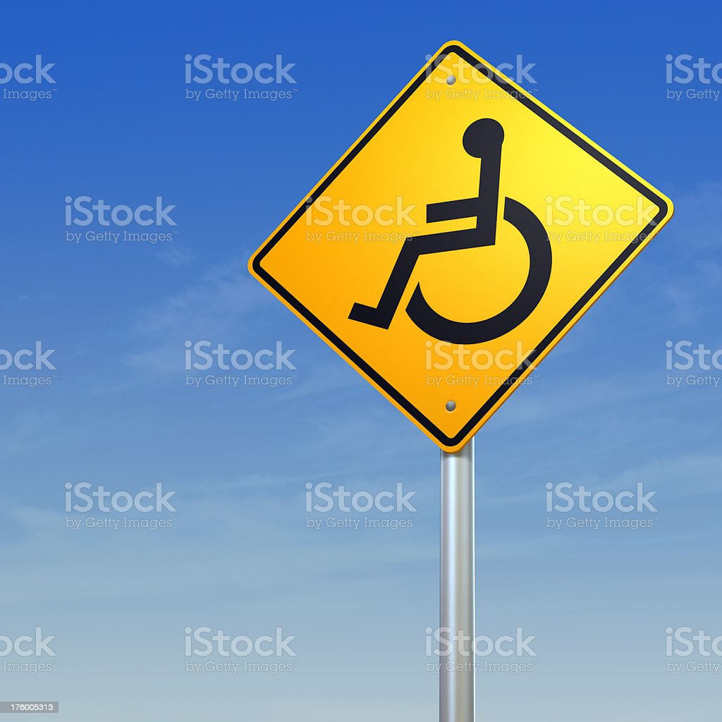 Wheelchair yellow warning road sign royalty-free stock photo