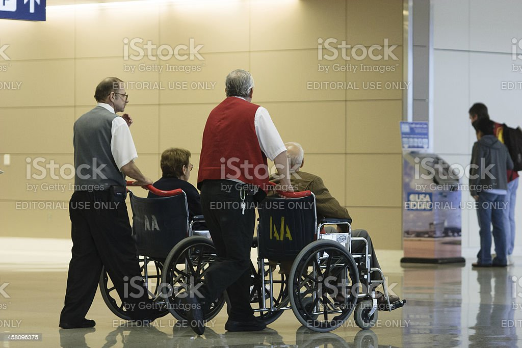 wheelchairs at the airport stock photo