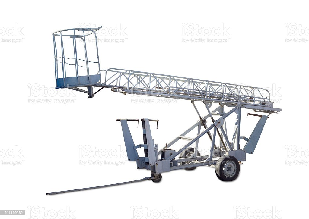 Wheeled articulated boom lift with lattice boom and basket stock photo