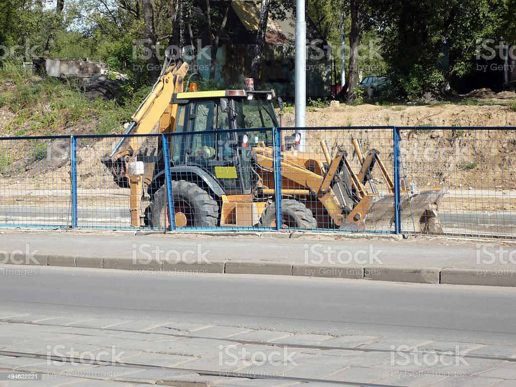 wheeled excavator on ground stock photo