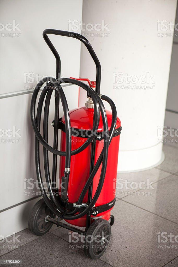 Wheeled fire extinguisher stock photo