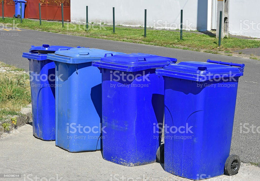 Wheeled garbage cans on the street stock photo