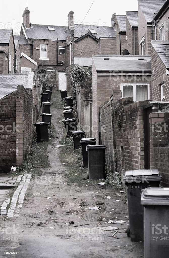 Wheelie bins in English alley stock photo