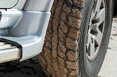 Wheels closeup in dry mud, off-road