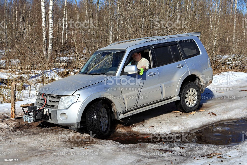 Wheels Jeep stuck in creek on  ice forest road. stock photo