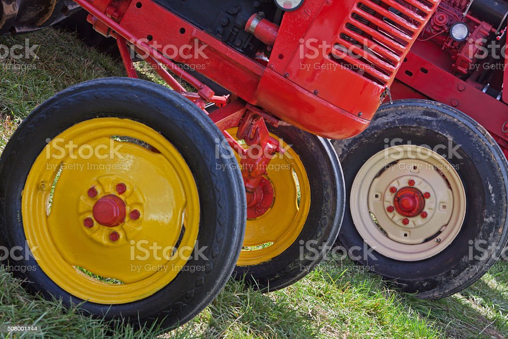 Wheels of restored vintage tractors at an agricultural show UK stock photo