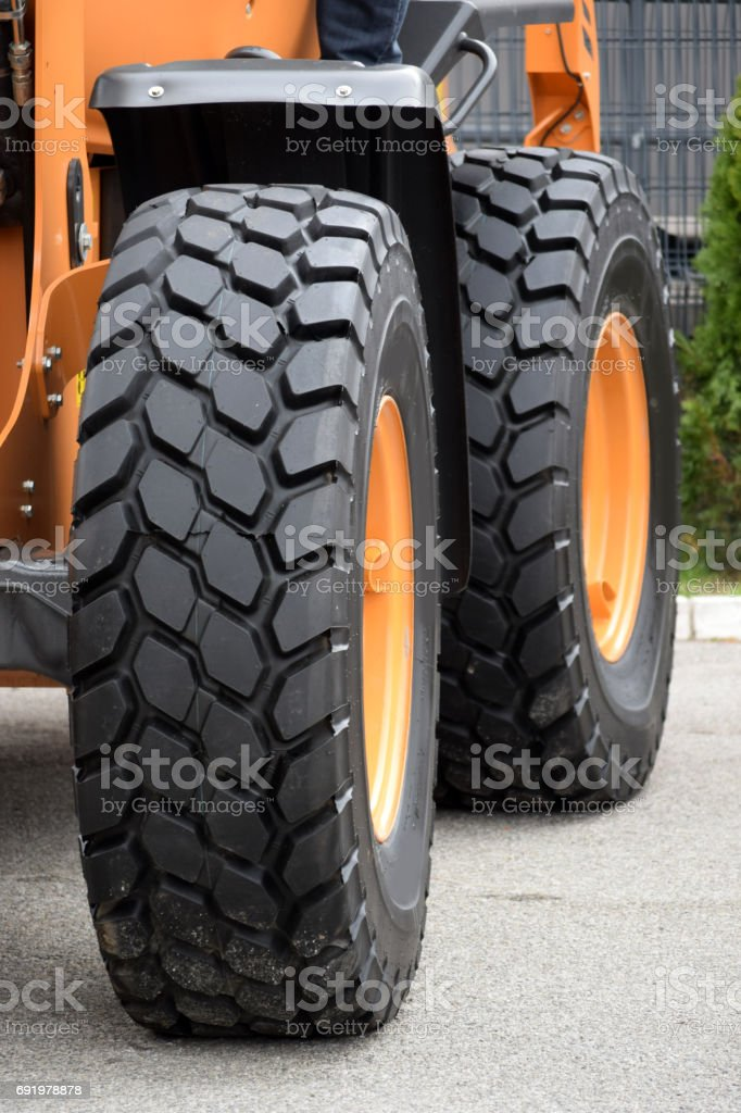 Wheels with tires, mode of  propulsion for  heavy construction vehicles stock photo