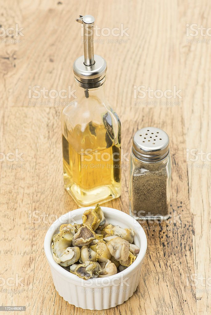 Whelks with vinegar and pepper royalty-free stock photo
