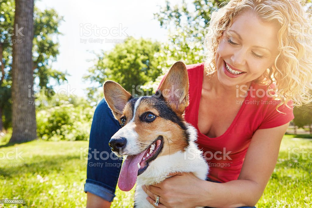When her dog is happy, she's happy stock photo