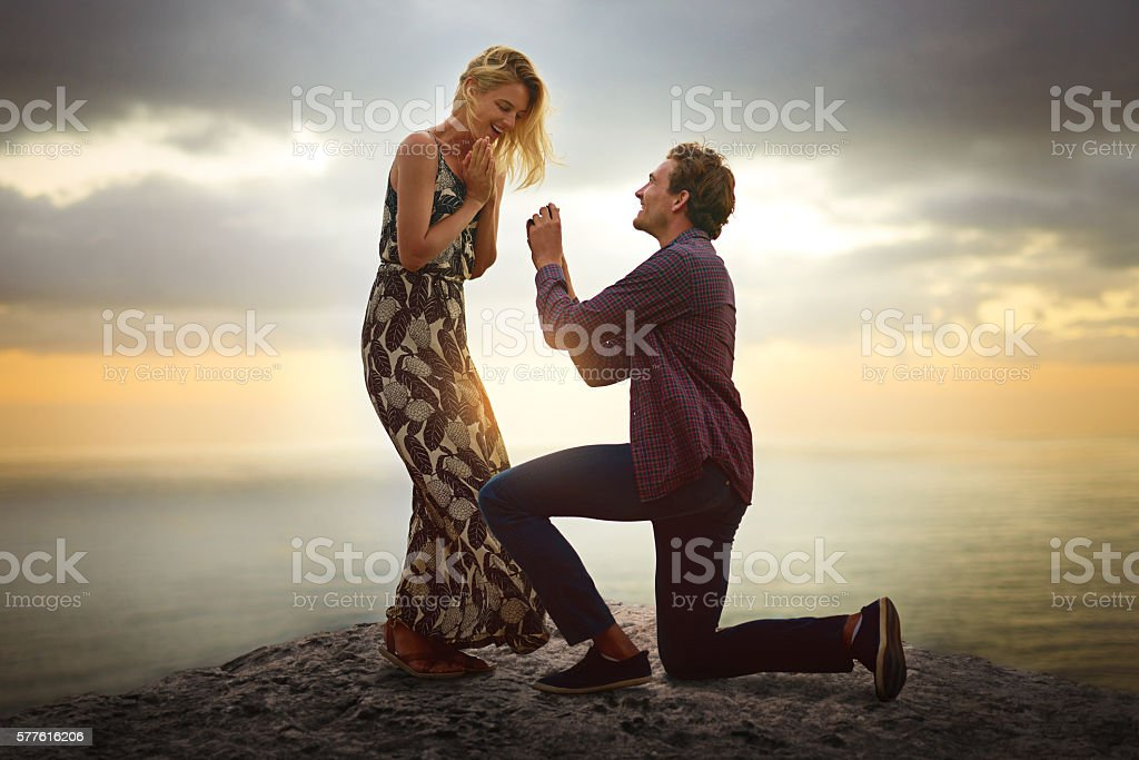 When her love brings you to your knees, marry her stock photo