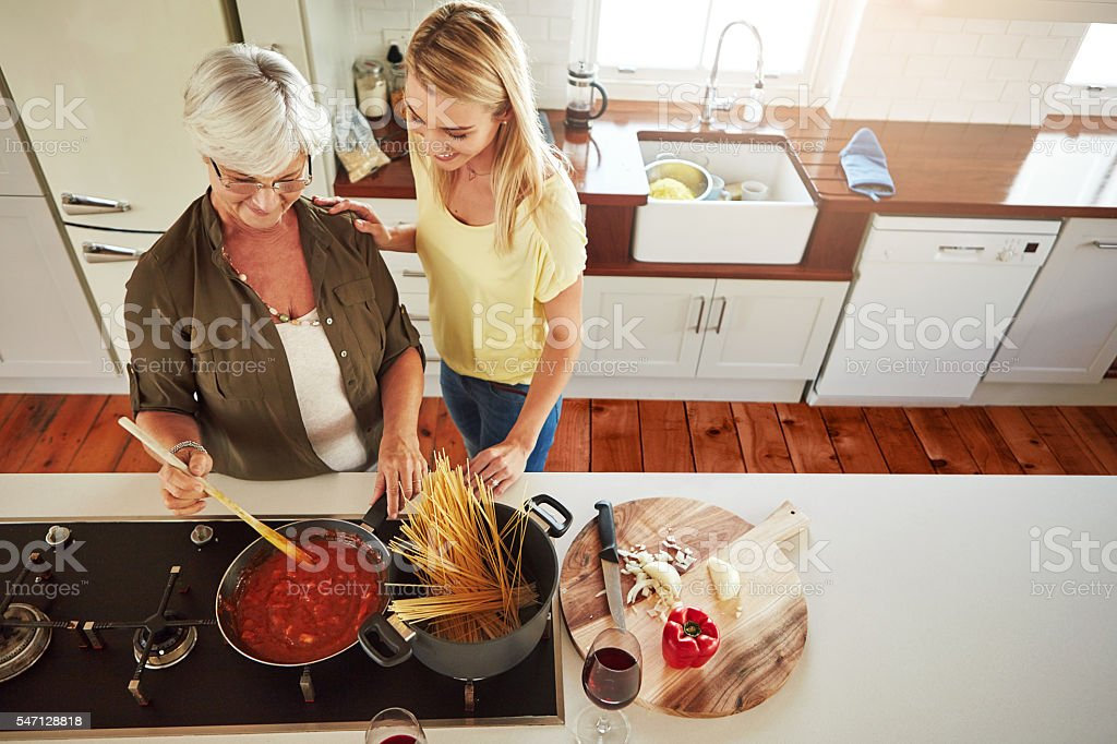When it comes to cooking, mom knows best stock photo