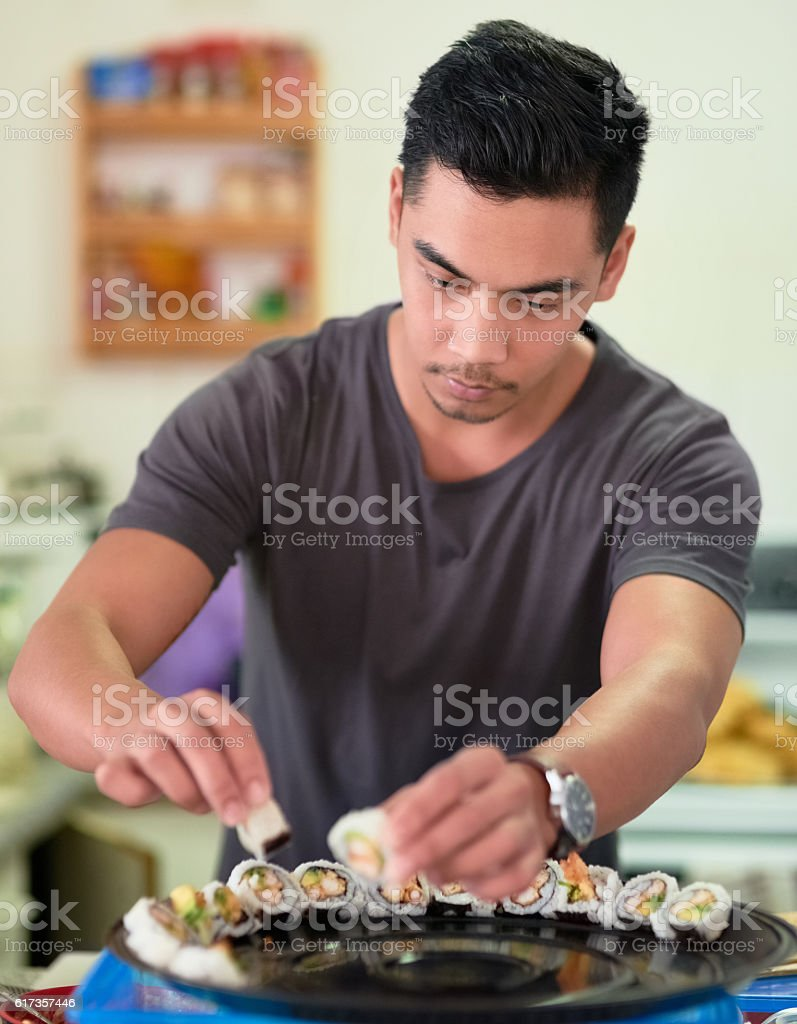 When it comes to sushi, he's a perfectionist stock photo