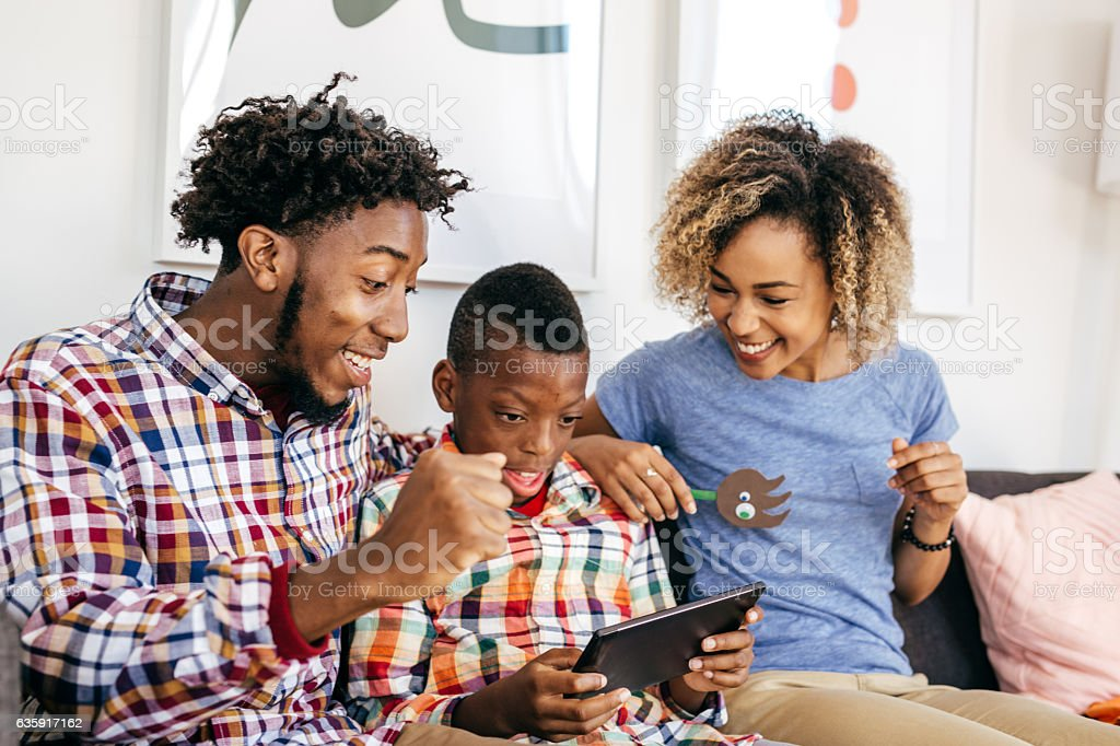 When parents likes online games stock photo