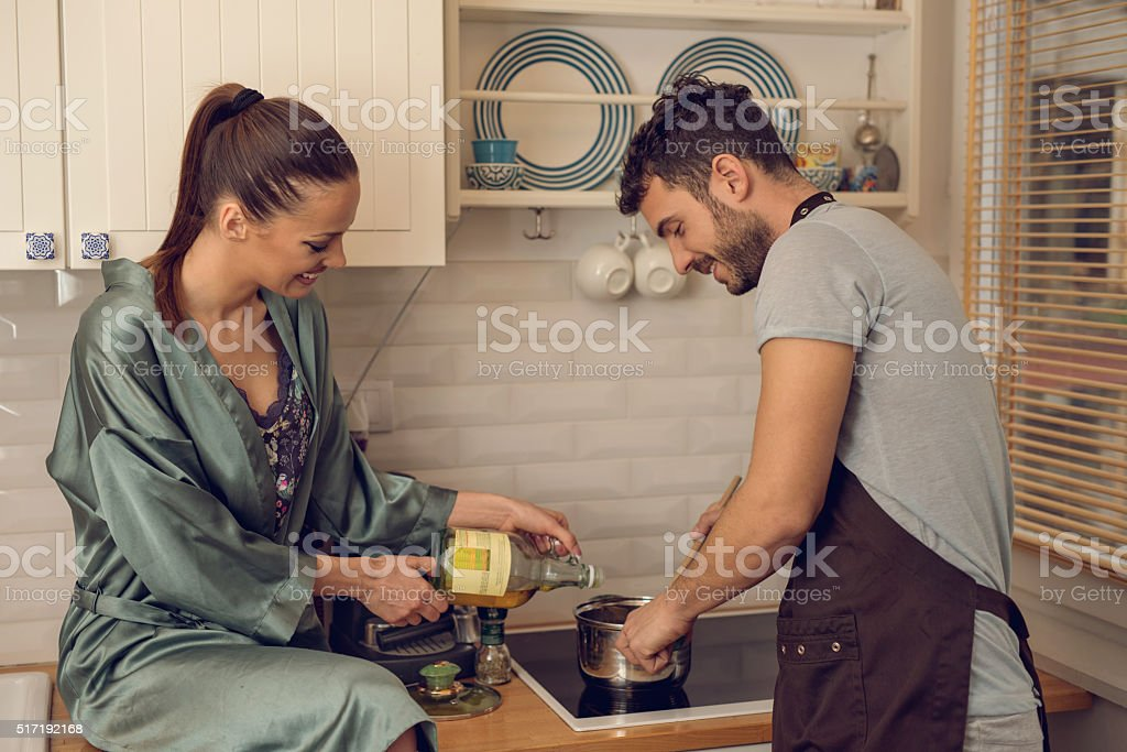When we cook together, food tastes much better! stock photo