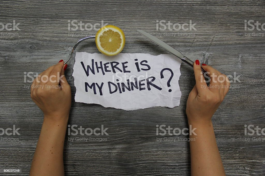 Where is my dinner? Fork with lemon and knife stock photo