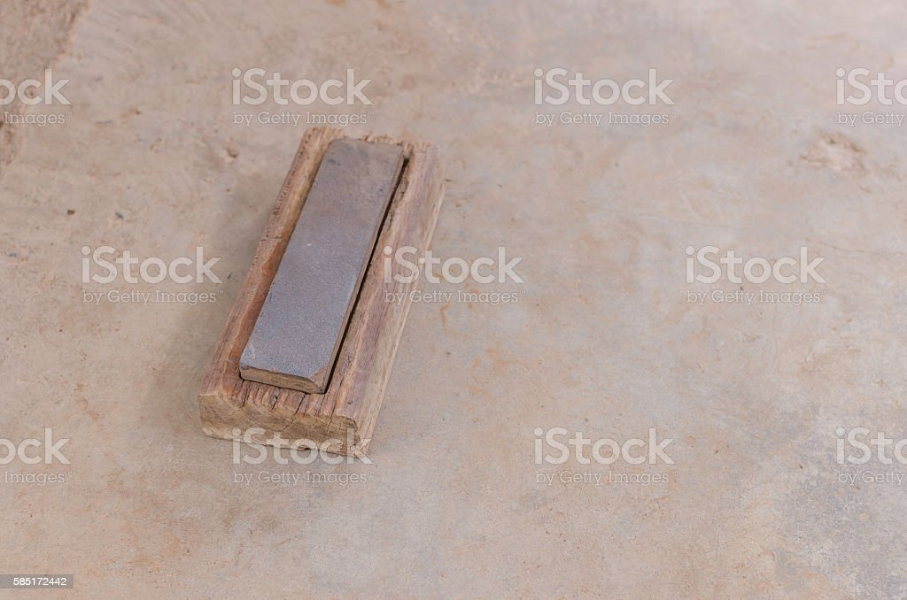 whetstone for knife in background stock photo
