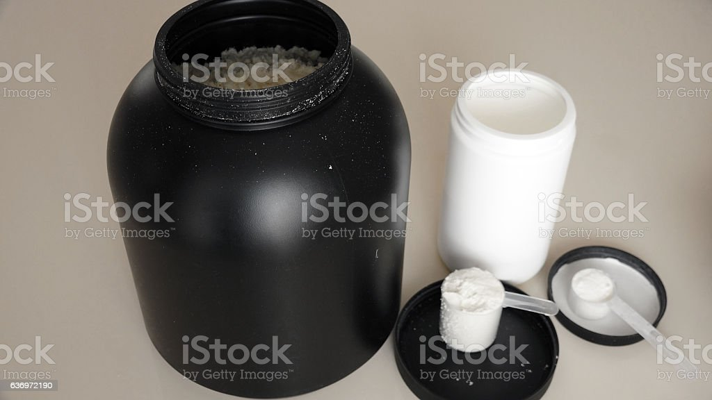 Whey protein and amino acids stock photo