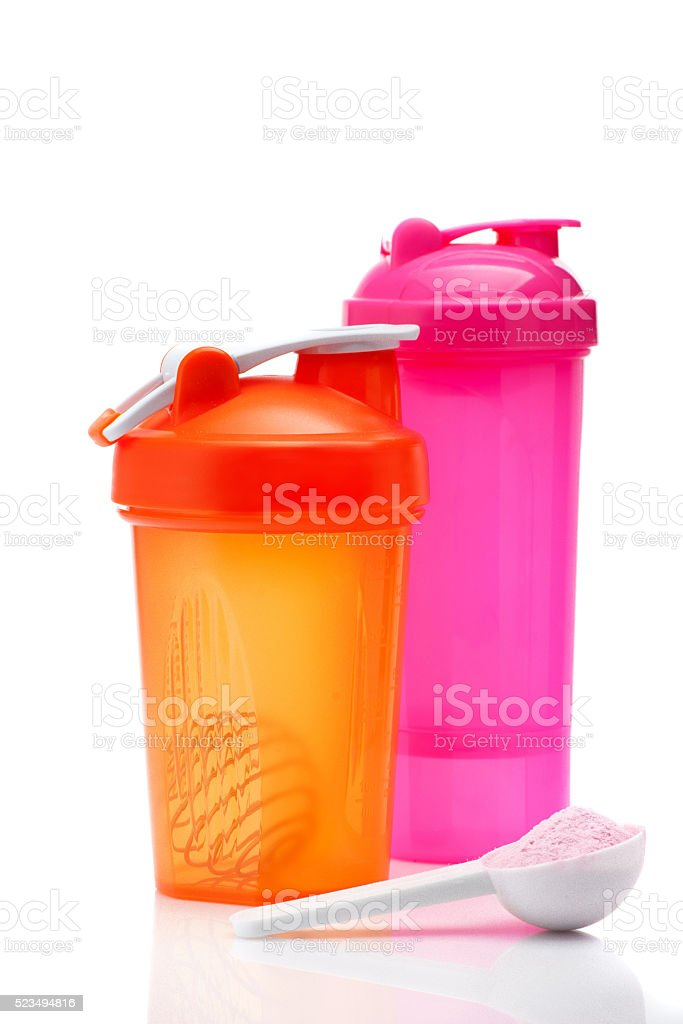 Whey protein powder and plastic shaker isolated on white stock photo
