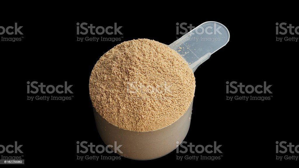 Whey protein powder scoop on a black background. stock photo