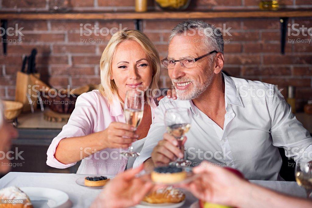While heterosexual couple tasting wine at restaurant stock photo