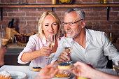 While heterosexual couple tasting wine at restaurant