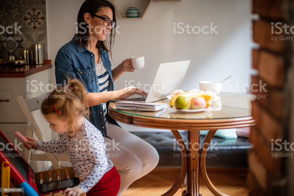 While mom is working... stock photo