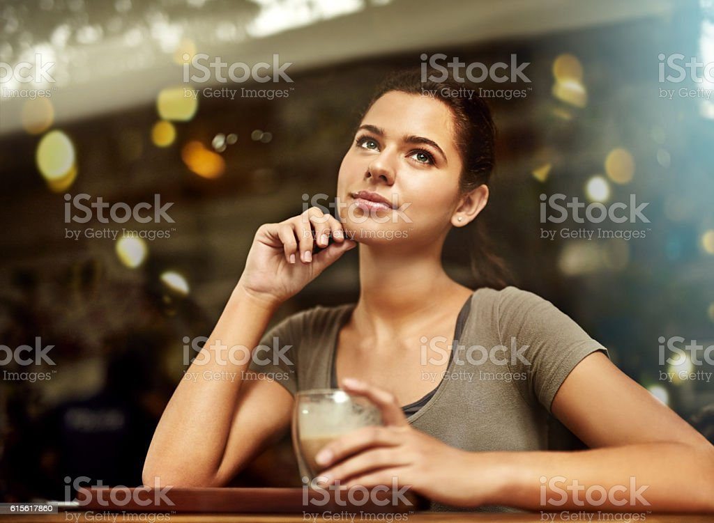 Whiling away the day in a cafe stock photo