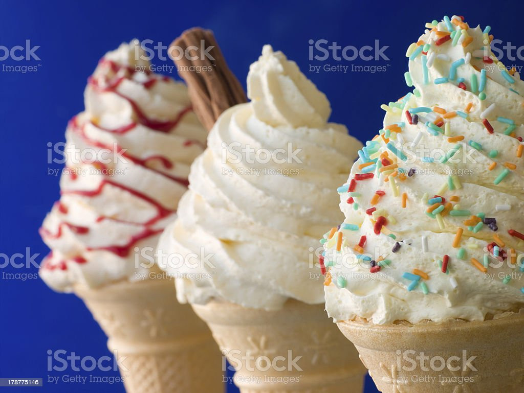 Whipped Ice Cream Cones with Three Different Toppings stock photo