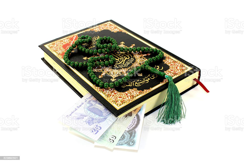 whipped Quran with Egyptian piastre stock photo