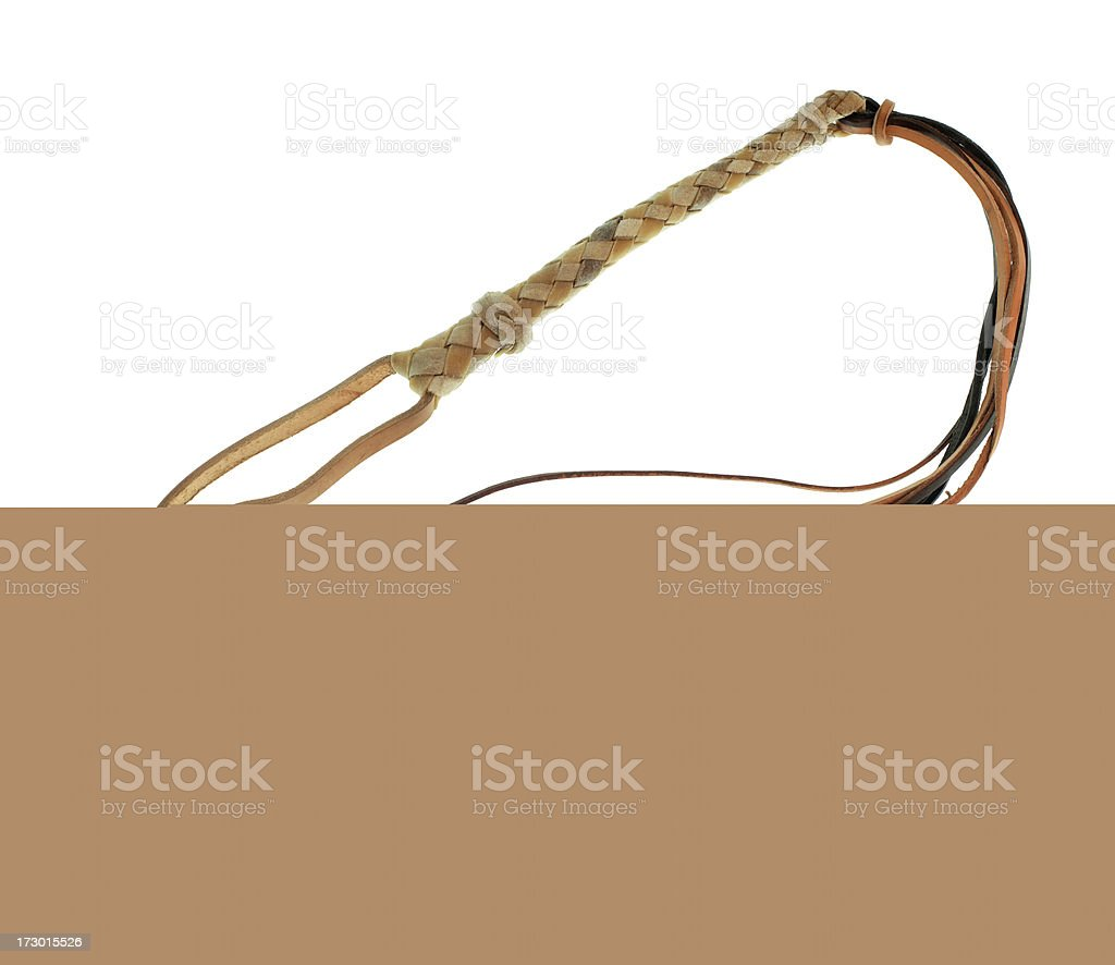 A whipping rope sticking out of the ground stock photo