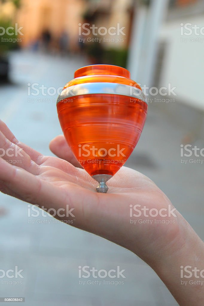 whipping top on a hand stock photo