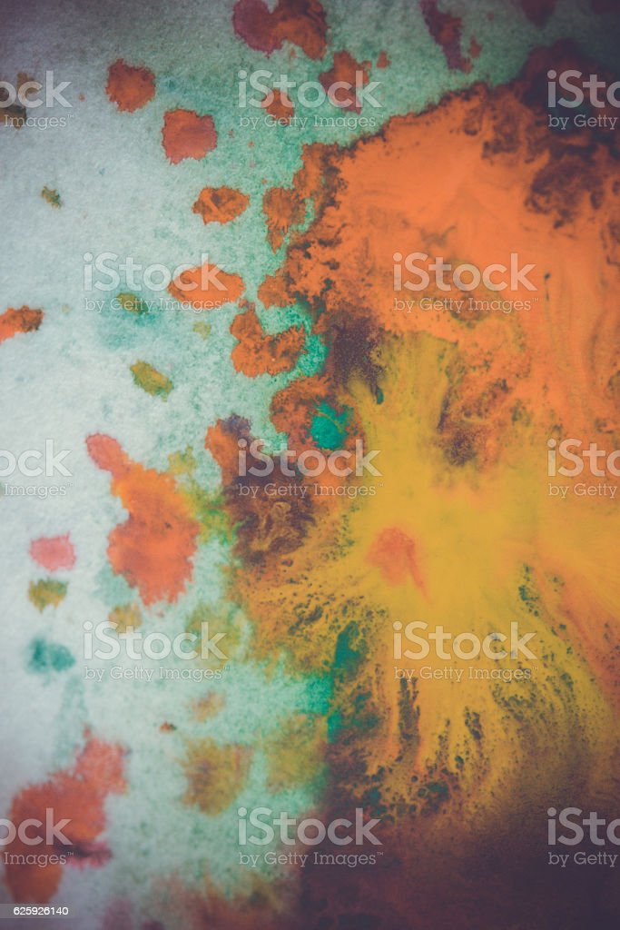 whirlwind vortex spreads colored ink colors on a white background stock photo