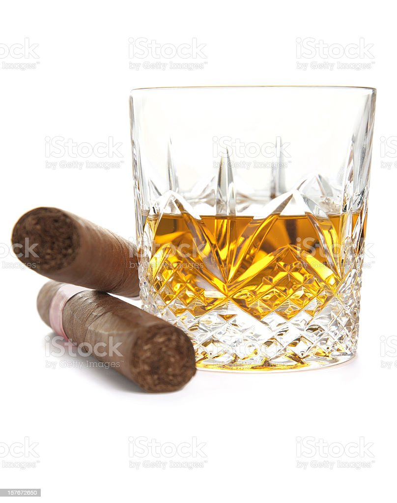 Whiskey and Cuban cigars on white background royalty-free stock photo