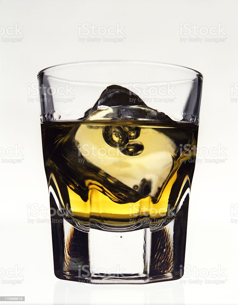 whiskey and ice in glass close-up royalty-free stock photo