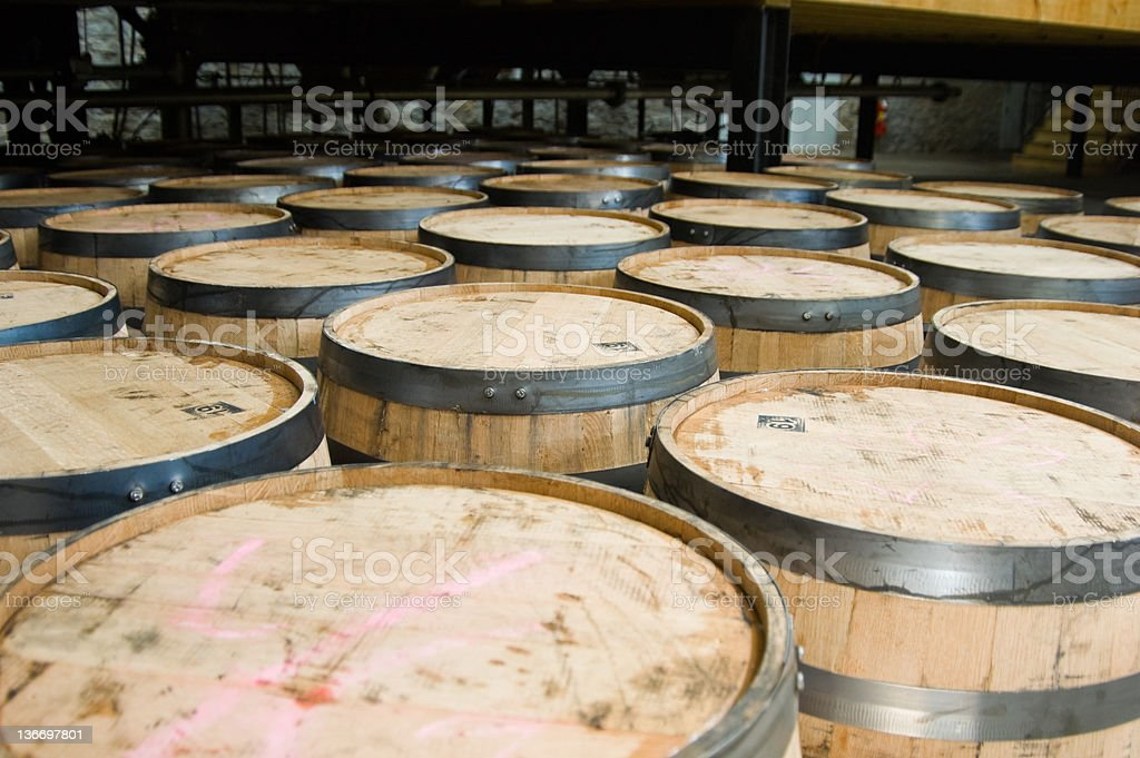 Whiskey Barrels, New in Storage Warehouse Rows royalty-free stock photo