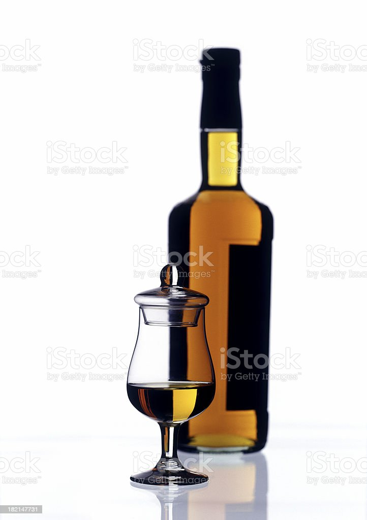 whiskey bottle and degustation glass with cover royalty-free stock photo