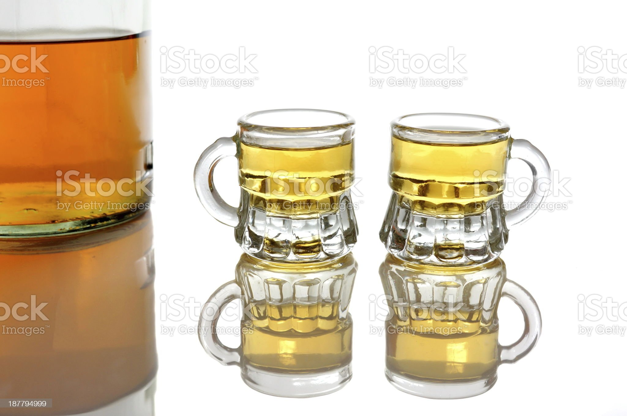 whiskey  bottle and two glasses isolated royalty-free stock photo