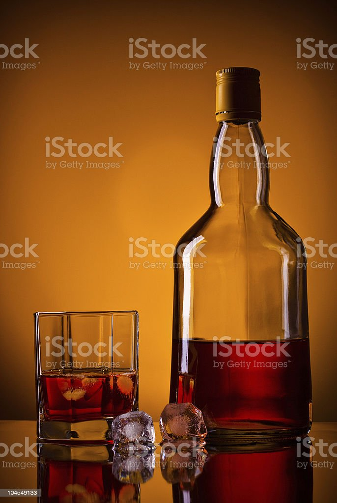 whiskey bottle, ice and glass royalty-free stock photo
