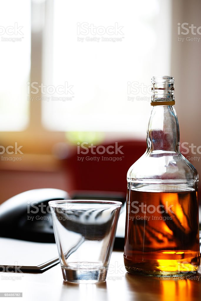 Whiskey bottle on the table stock photo