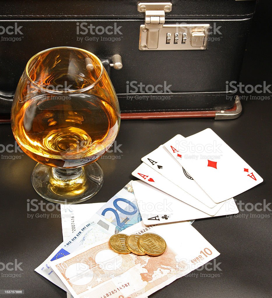 Whiskey, cards and money stock photo