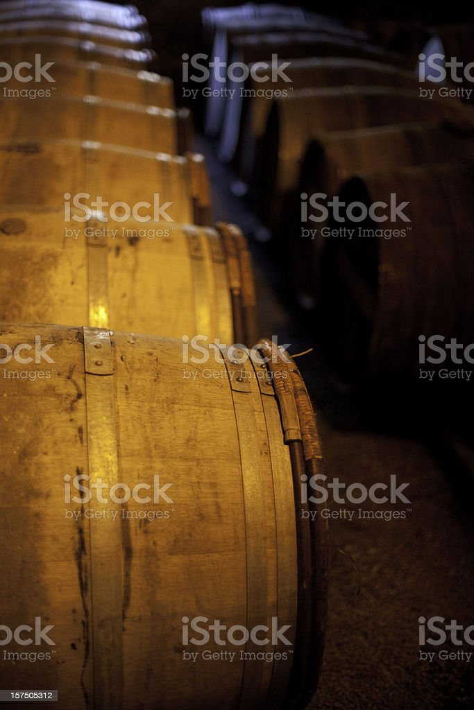 Whiskey casks in a Scotch distillery. royalty-free stock photo