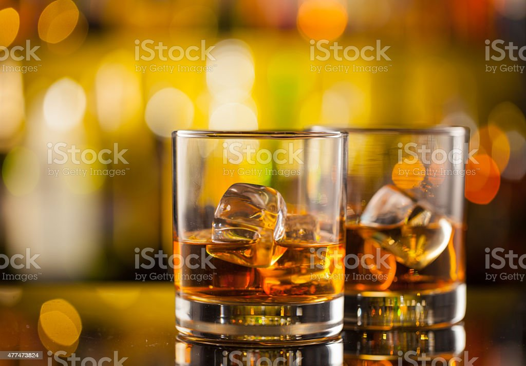 Whiskey drinks on bar counter stock photo