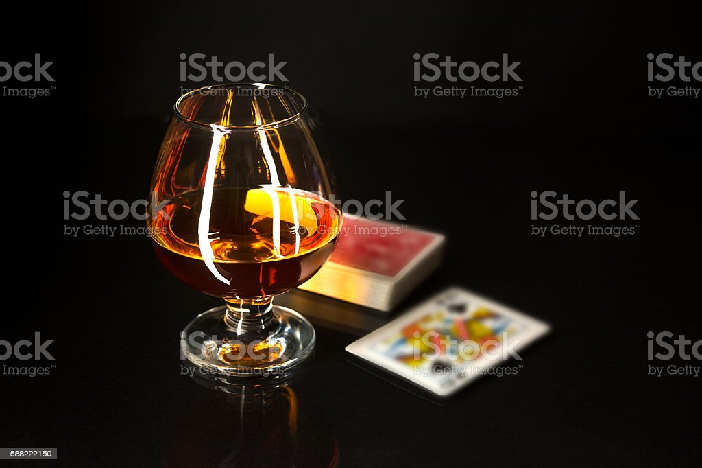 Whiskey glass and playing cards stock photo